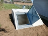 A below ground concrete tornado shelter.