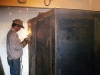 Finishing welding edges of in-home storm shelter