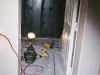 We cut hole in customers wall, installed steel shelter, installed a FEMA 320 door to enter their shelter off hallway.