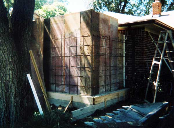 Concrete storm shelter attached to house; entry from inside house.