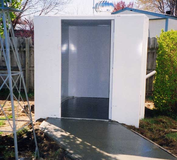 6 x 8 steel, handicap accessible storm shelter with a poured concrete floor.